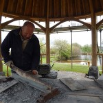 Gary trims each slate before they're hoisted up