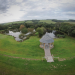 Aerial view of the lakes and lakeside arbour at Hendra Barns