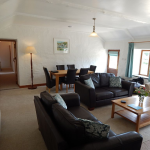 Comfortable living/dining room, from kitchen, with door onto garden.