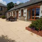 Large patio with high-quality furniture (inc parasol) and bbq.