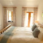 Bedroom 1; double, with access onto garden.